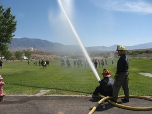 Littlefield fire department shooting water at students.