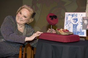 Rose Marie poses with a hair bow and shoes from her Baby Rose Marie days donated to the Smithsonian's Museum of American History in 2008