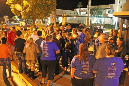 Many of Mesquite's residents came together Tuesday night in front of City Hall to gather and hang yellow ribbons around Mesquite to honor Ethan Mendenhall, a ten-year-old boy who passed away from Stage IV Neuroblastoma on Monday night. Photo by Kris Zurbas.
