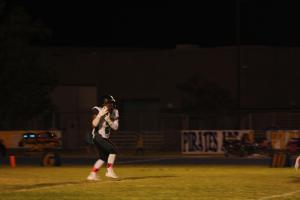 Senior running back Junior Paongo receives a kickoff during a recent game. Paongo led the Bulldogs with 117 yards Friday night in a win over Boulder City 27-21. Photo by Lou Martin