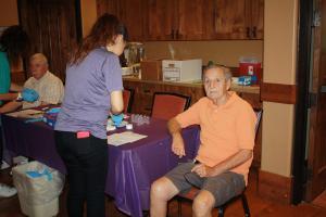 Korean War Veteran Norbert Musil has blood drawn at the Veterans Health Fair Saturday morning. Photo by Lou Martin