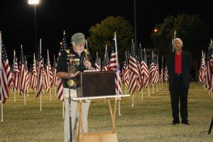 Mesquite Mayor and Veteran Al Litman reads welcoming remarks as Master of Ceremonies Paul Benedict looks on. Photo by Lou Martin.