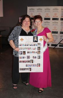 Cindi Delaney, left, stands with Ms. Senior Mesquite Founder, Jean Watkins after the gala on Saturday with a board of all of the participants in the pageant's 10-year history. Photo by Jim Lavender.