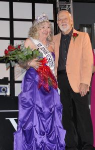 Presenting the 2015 Ms. Senior Mesquite Queen, Loretta Green, standing here with her husband, Councilman Rich Green. Photo by Jim Lavender.