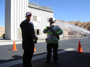 Chief Kash Christopher gets an update from Deputy Chief Rick Resnick about the status of operations at the simulated event last Saturday. Photo by Stephanie Frehner.