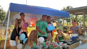 The Virgin Valley High School Cheerleaders had the responsibility of selling balloons to attendees of the fundraiser. Each balloon, even the few that flew away, had a number in them that was worth redeeming for a prize at the end of the night. Photo by Stephanie Frehner.