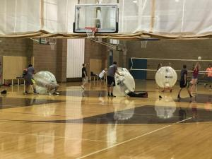 Students had a blast in the gym with their human-sized bubbles and volleyball courts. Photo by McQuade Chesley.