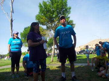 Pam Bruehl coordinator for the Mesquite Walk in Memory/Walk for hope along with Director, Brad Easton, of the Mesquite Behavioral Health Center address the crowd of supporters before the beginning lap of the 2015, 4th annual event aimed at raising suicide awareness throughout the state of Nevada. Photo by Teri Nehrenz.