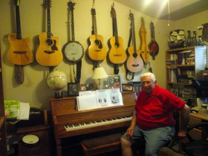 Blair Adams displays an impressive collection of guitars, banjos and mandolins on the walls of his office/studio.