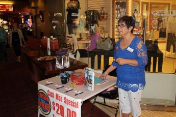 Lydia LeDuc was on hand Saturday, Sep. 26 to help promote the Mesquite Chamber of Commerce Cash Mob at J.S. Merchants gift shop. Photo by Barbara Ellestad.