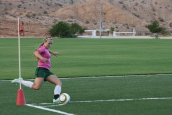 Bulldog Abbie Barnum scores goal seven minutes into match with archrival Moapa Valley. Barnum had both goals for the Dawgs in their 2-0 win over the Pirates. Photo by Lou Martin
