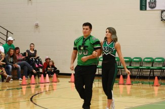 Homecoming King and Queen Jairo Vallejo and Brooke Lee enter the gym to a huge ovation Thursday Oct.22. Photo by Lou Martin
