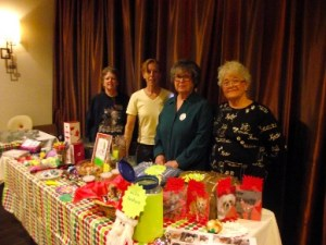 Vendors such as We Care for Animals' Joanne Migliozzi, Nancy Robillard, Karen Taylor and Sandy Hughes had tables full of items to be sold to raise money for their non-profit organizations.  Photo by Teri Nehrenz.