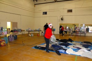 Salvation Army volunteers sorted and organized a great many toys for the Toys for Tots distribution on Dec. 18.  The coats in the middle of the gymnasium floor were collected as part of the Coats for Kids Program and donated to the Toys for Tots by Joe Aquino, Local Volunteer Coordinator for the Coats for Kids Program.  Photo by Teri Nehrenz.