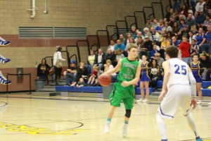 Bulldog point guard Jarrett Tietjen #2 looks over the Pirates defense during the Dawgs 42-38 loss at Moapa Valley Friday night. Tietjen had 10 points to lead the Dawgs. Photo by Lou Martin
