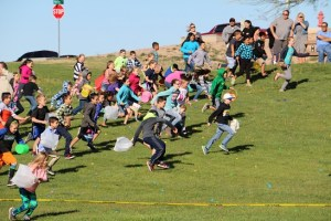 Hundreds of kids delighted at the chance to find a golden egg among the many spread through the grass at Marilyn Redd Park during the annual Easter egg hunt sponsored by the Las Vegas Summerlin Lions Club Saturday morning, March 26. Photo by Barbara Ellestad.