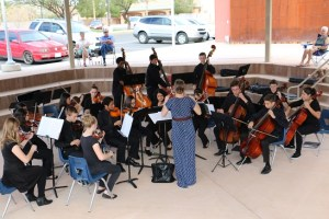 Kendra Graff, Virgin Valley High School orchestra leader leads the musicians in an outdoor concert as practice for an upcoming Clark County festival competition. Photo by Barbara Ellestad.