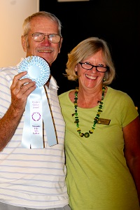 VVAA President Katherine Cole presents artist Floyd Johnson the ribbon for People's Choice for his acrylic painting of 'The Donald'.  Photo by Teri Nehrenz