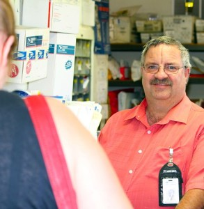 Douglas Adriance, Postmaster in Littlefield, AZ was recently named Postmaster of the Year by the National League of Postmasters Arizona Chapter.  Adriance is photographed helping an Arizona resident with her postal needs.  Photo by Teri Nehrenz