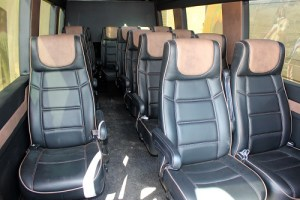 Brand new state of the art busses will provide you door-to-door service for your camel adventure from the Eureka Hotel Casino.  Busses are equipped with charging ports for every seat.  Photo by Teri Nehrenz