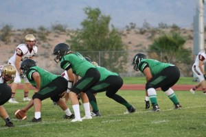 Bulldog offensive line in a recent game. The Dawgs stepped up in the fourth period opening hole for running back Jayden Perkins. The Dawgs won 12-0 over the Rattlers. Photo by Lou Martin