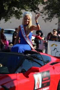 Ms. America International, Tracy Rodgers, Rides in celebration and honor of Veteran's all over in the 2016 Mesquite Veteran's Day Parade. Photo by Teri Nehrenz