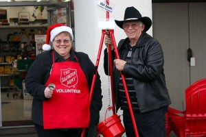 Jacqueline and Blair Adams are the first bell ringers to kick off the 2016 Salvation Army kettle campaign. Jacqueline has been ringing the bell for the collections every Monday morning for the past 12 years and hubby Blair has joined her for the past four. Photo by Teri Nehrenz