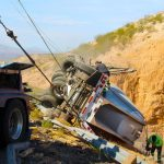 Semi goes over embankment, driver escapes uninjured