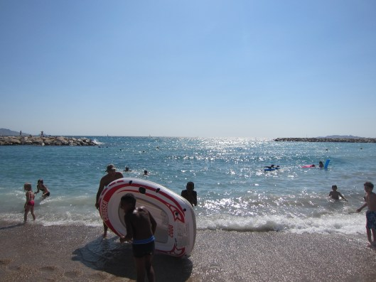 Marseille Kids with Raft on Beach