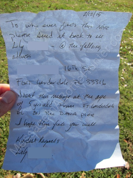 Close up of Lily / Ft. Lauderdale message in a bottle