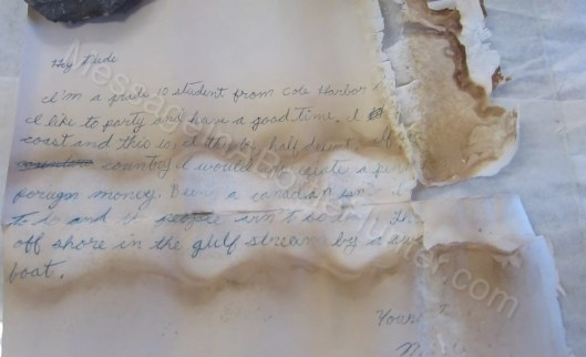 Full text / front of 1985 Nova Scotia message in a bottle close up.