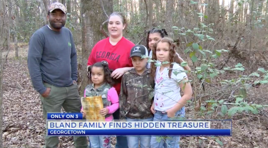 Christopher and Emily Bland of Georgia with Family and message in a bottle they found