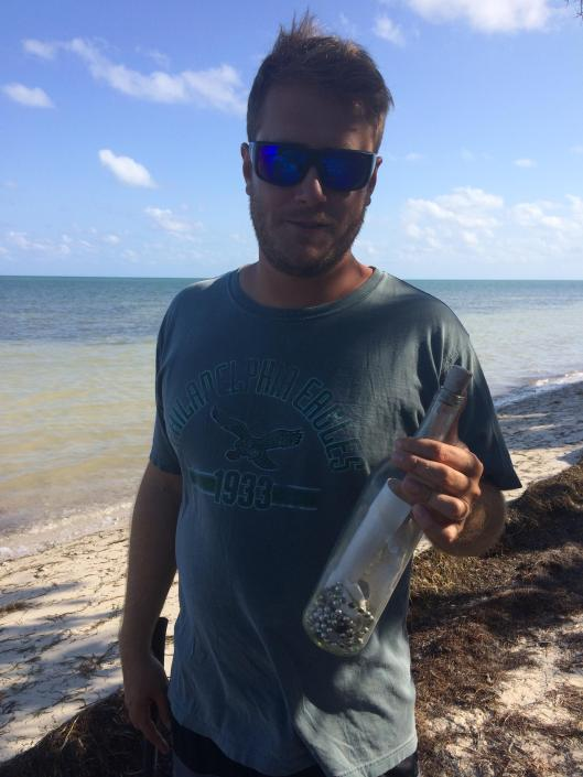 """Imgur user """"Moskeytoes"""" with the Mardi Gras message in a bottle he found in the Florida Keys, complete with """"authentic Mardi Gras beads""""."""