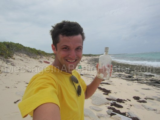 Clint Buffington with hopeless message in a bottle on beach