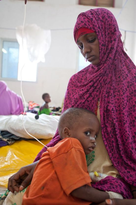 A woman and her child receiving treatment for malnutrition. (Credit: ICRC)