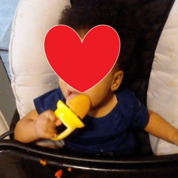 My daughter eating a banana/carrot/mango popsicle