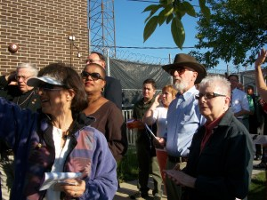 A crowd prays at a detention center in Illinois, June 2012, blessing a bus as it brings immigrants to the airport to be deported. Photo by Julia Walsh FSPA
