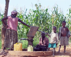Ugandan family at water well