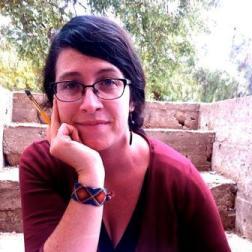woman-red-shirt-glasses-black-hair-watch