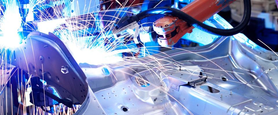 Robot welding a brace component to a car body