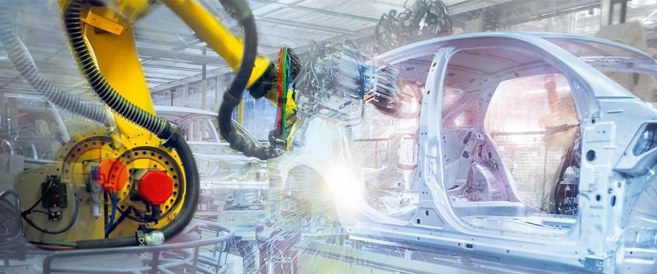 Robot welding a car body in white