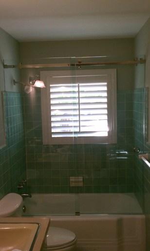 3. Deslizante tubo rectangular arriba de bañera
