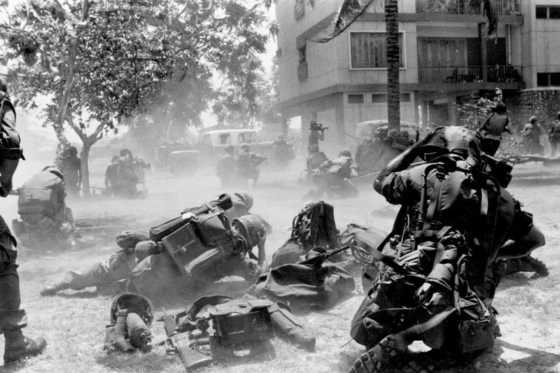 U.S. Marines come under Khmer Rouge fire while they were on the ground near the U.S. embassy during Operation Eagle Pull which evacuated American and embassy personnel in Phnom Penh, Cambodia, on April 13, 1975. (Tea Kim Heang/AP)