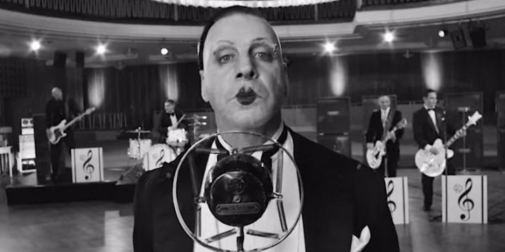 An image captured from Rammstein's 'Radio' music video. The image shows Rammstein dressed as an old 1920's era band in tuxedos,.