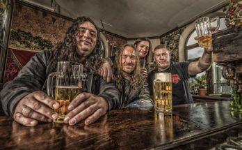 Photo of Tankard sat at a bar drinking beer