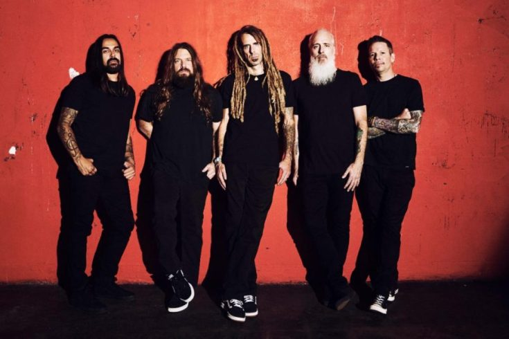 Photo of Lamb of God standing against a red backdrop.