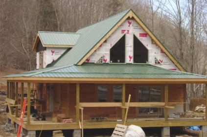 This Ontario home isn't finished yet, but Metal Roof Outlet's efficient team has already installed a beautiful forest green metal sheet roof.