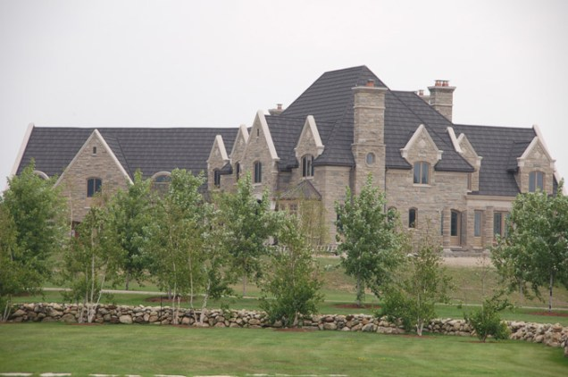 This classic stone building has a charcoal steel shake roof installed by Metal Roof Outlet, Ontario.