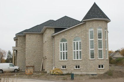Here is another look at this beautiful, sloped roof that leads to a narrow turret.