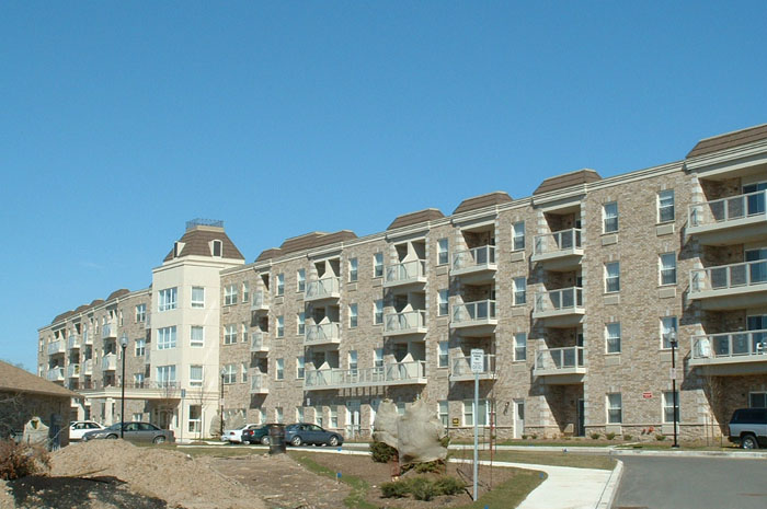 This beautiful condominium complex chose a brown metal shingle. Metal Roof Outlet installed a roof that looks great and raises the value of the units, and will protect the building's integrity for decades.